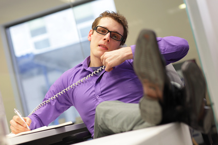bad sitting posture - business man on phone