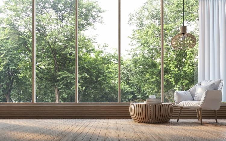 Minimalistischer Wohnstil - cleane Sitzecke vor großer Fensterwand